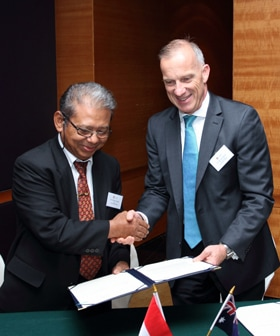 Dr Spence signs an agreement with the Rector of Jakarta State University, Bedjo Sujanto.