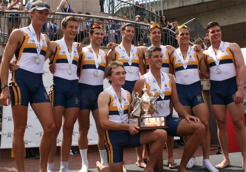 The University of Sydney men's eight celebrate with the Edmund Barton Trophy.