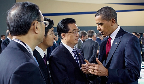 US President Barack Obama speaking to Chinese President Hu Jintao.