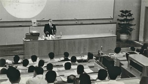 Christiansen lecturing at a science symposium in Beijing in 1964.