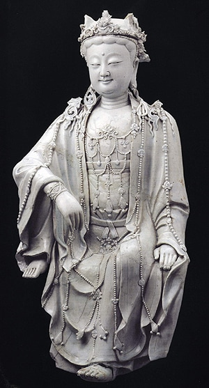 14th century Chinese porcelain figure of Bodhisattva of Compassion. Unearthed in Beijing and now in the Capital Museum, it is similar to ceramic figures found in Southeast Asia including Ankgor that were probably brought and worshipped there by early Chinese emigrant traders.