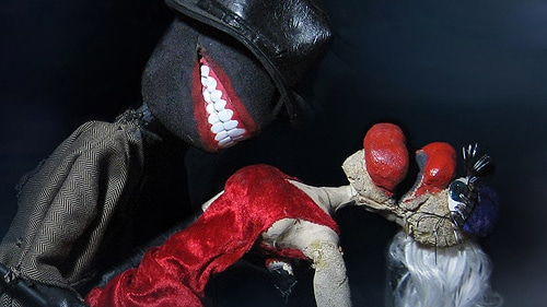 In 'Murder', the grin of death is borrowed and amplified many times over in their puppet version of the show's dominating figure - the semi-mythical Stagger Lee. [Image: Susannah Wembley]