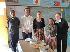 Agriculture student Adam Briggs, medical student Amelia Street and education student Paris Esposito, with staff at Maubisse Primary School, Timor Leste.