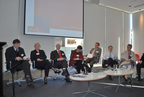 Panel members in the final conference session, chaired by Professor Simon Chapman from Sydney Medical School.  L to R: Professor Roger Magnuson (Sydney Law School); Professor Ruth Bonita ONZM (Co-Director, International Public Health Consultants, Auckland); Professor Ian Olver (CEO, Cancer Council Australia); Margaret Hamilton AO (Vice-President, Cancer Council Victoria); Professor Robert Beaglehole ONZM; Mr Jonathan Liberman (Senior Legal Policy Adviser, International Union Against Cancer); Paricia Lambert (Director, Legal Consortium, Campaign for Tobacco-Free Kids, Washington D.C.).  Partly obscured: Professor David Hill AO, Director of the Cancer Council Victoria and President, International Union Against Cancer.
