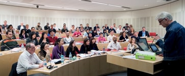 Postgraduate students attending a lecture in one of the purpose-built law seminar rooms