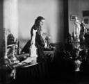 Professor Woolley's residence, interior, woman with statues.