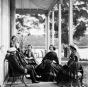 William Wright and friends at Drummoyne Park. Group on verandah.