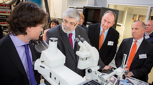 (L-R) Professor David Reilly gives The Hon Kim Carr, The Hon John Murphy and Vice-Chancellor Dr Michael Spence a demonstration of the Australian Institute for Nanoscience's work.