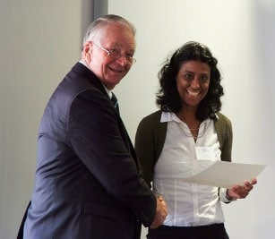 Sonia Brazao (right) receiving her fellowship from Charlie Shuetrim (left - SIMS Foundation Chair)