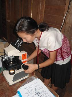 Microscopes donated by the School of Biological Sciences arrive at a refugee school in Thailand
