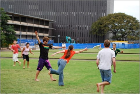 Postgraduate Students Frisbee at Front Lawns