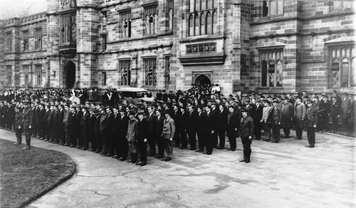 Volunteers assembled in front of the Main Building