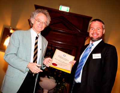 Professor Ben Eggleton receiving his Fellowship certificate from the Australian Academy of Technological Sciences and Engineering at a ceremony held in Brisbane on 15 November 2009. Photo: ATSE.