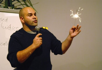 Peter Domachuk, from the School of Physics, explains his research in plain language - in the time it takes for a sparkler to burn out - to a crowd at 'Fresh Science at the Pub', in Melbourne.