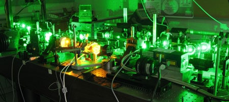 Professor Barry Luther-Davies will celebrate 50 years since the first laser in his Sydney Science Forum - 'Beaming with pride'. This photo in Professor Barry Luther-Davies' lab shows a high power solid state laser being used to generate yellow light for a sodium laser guide star, designed for use in an adaptive optics system for astronomy. The system converts infrared light to green light and then yellow.