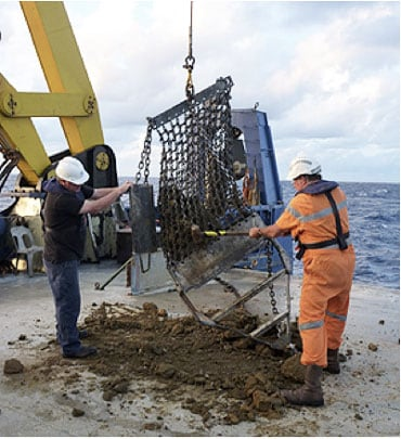 Collecting rocks: University of Sydney scientists dredge rock samples onto the Southern Surveyor vessel from the two newly discovered islands, now in water depths of over 1.5km.