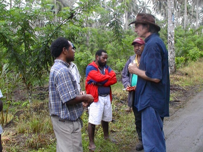 Professor David Guest in Papua New Guinea with local scientists John Konam (left) and Anthon Kamuso (centre) with cacao farmers. Hear about how his work with smallholder cacao producers is helping avoid a global chocolate catastrophe in his Sydney Science Forum: The Chocolate Crisis.