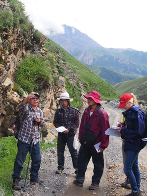 Professor Shuguang Song, from Peking University, shows students on the joint field trip the geological features of the northern margin of the Qinghai-Tibet Plateau.