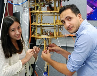 Alice Mahoney and James Colless, School of Physics PhD students, have found a new charge detection method that brings scaling-up quantum devices to useful sizes closer to reality. Here they are preparing a dilution refrigerator for experiments on quantum dots, as temperatures close to absolute zero are required to study the quantum behaviour.