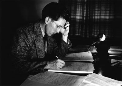 Professor Walter Stibbs writing his highly regarded textbook 'The Outer Layers of a Star' - pictured here in Canberra in 1950.