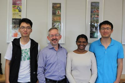 The first recipients of the new Dean's International Postgraduate Research Scholarship with Professor Trevor Hambley (second from left), Dean of the Faculty of Science, are: (l-r) Pengju Bian, Nuwanthika Fernando and Yifan Gu.