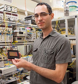 Dr Simon Lefrancois from the University of Sydney's School of Physics holding an optical chip used in the terabit oscilloscope.