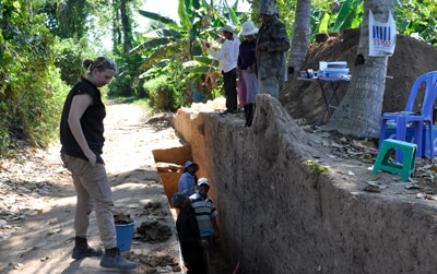 A researcher from the Angkor Research Program examines an excavation - Martin Polkinghorne
