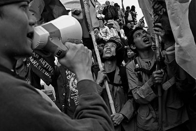 People take part in a protest in Indonesia - Henri Ismail